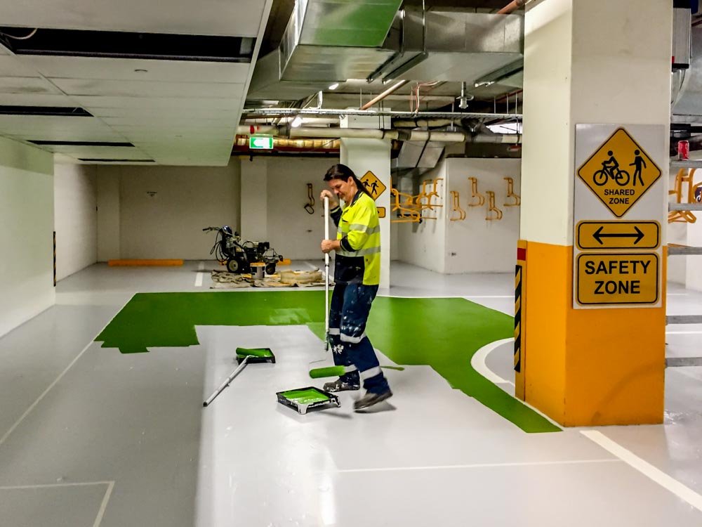 Garry applying floor colour bankstown