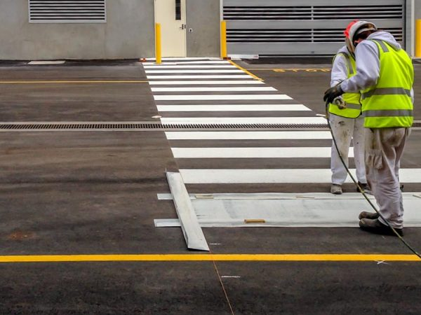the boys applying some speed humps line marking and bollards